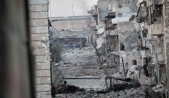 In this Wednesday, Oct. 31, 2012 photo, shows the destruction along a street in the Karm al-Jebel neighborhood of Aleppo, Syria. Violent clashes re-ignited along the city's frontline while government warplanes attacked rebel controlled areas throughout the financial capital of Syria's largest city. (AP Photo/Narciso Contreras).