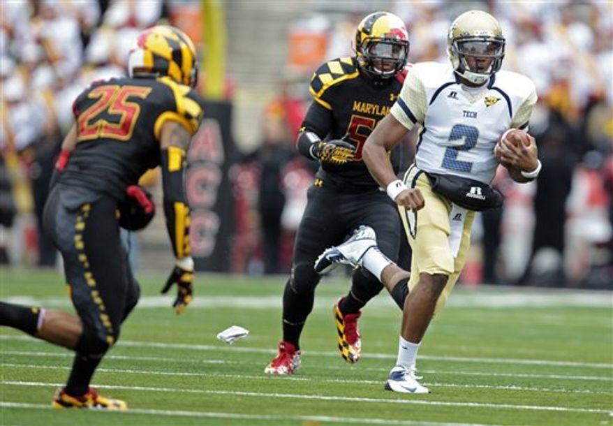 Georgia Tech quarterback Vad Lee (2) runs the ball as Maryland defensive back Dexter McDougle (25) and linebacker Darin Drakeford (52) defend during the first half of an NCAA college football game, Saturday, Nov. 3, 2012, in College Park, Md. (AP Photo/Luis M. Alvarez)