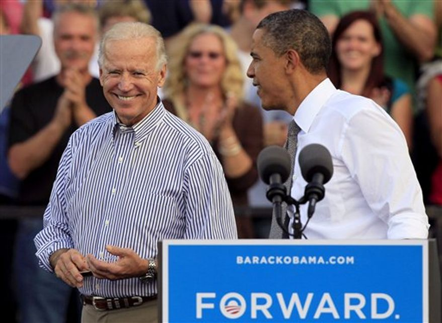 FILE - In this Oct. 23, 2012 file photo, President Barack Obama takes the podium after being introduced by Vice President Joe Biden at a joint campaign rally, at Triangle Park in Dayton, Ohio.
