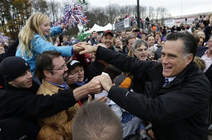 Republican presidential candidate and former Massachusetts Gov. Mitt Romney greets supporters as he campaigns at Portsmouth International Airport, in Newington, N.H., Saturday, Nov. 3, 2012. (AP Photo/Charles Dharapak)