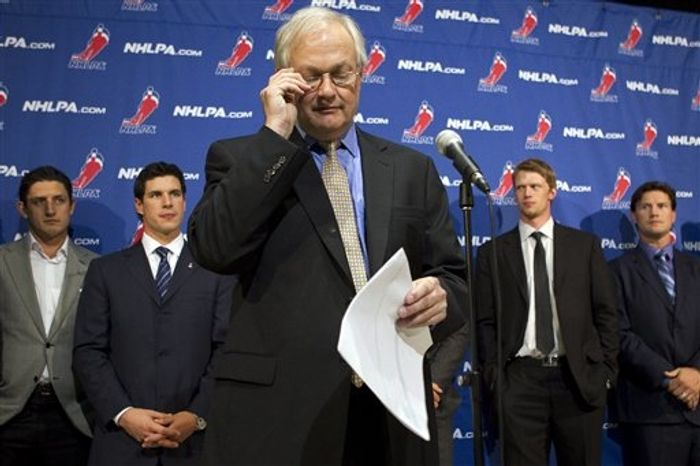** FILE ** NHL Players' Association executive director Donald Fehr, center, glances at his notes as he stands in front of players, including Pittsburgh Penguins' Sidney Crosby, second from left, following collective bargaining talks in Toronto, Thursday, Oct. 18, 2012. (AP Photo/The Canadian Press, Chris Young)