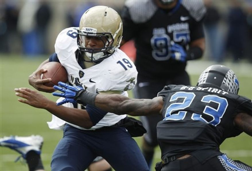 ** FILE ** Navy quarterback Keenan Reynolds, left, runs for a touchdown past Air Force defensive back Steffon Batts in the fourth quarter of Navy's 28-21 overtime victory in an NCAA college football game at Air Force Academy, Colo., on Saturday, Oct. 6, 2012. (AP Photo/David Zalubowski)