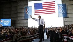 Republican presidential candidate and former Massachusetts Gov. Mitt Romney campaigns at Colorado Springs Municipal Airport in Colorado Springs, Col., Saturday, Nov. 3, 2012. (AP Photo/Charles Dharapak)