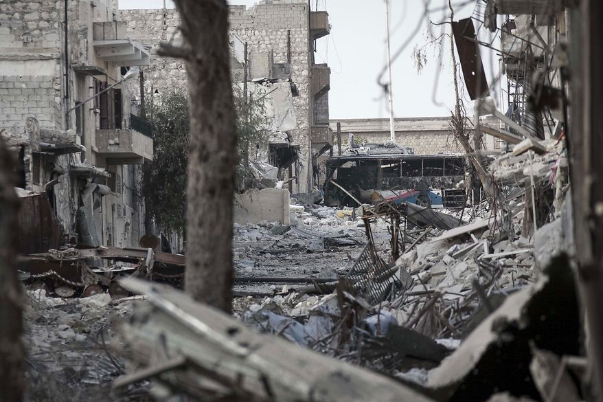 In this Friday, Nov. 2, 2012, photo, damaged buildings are seen along a desolated street in the Karm al-Jebel battlefield after several days of intense clashes between rebel fighters and the Syrian army in Aleppo, Syria. (AP Photo/Narciso Contreras)
