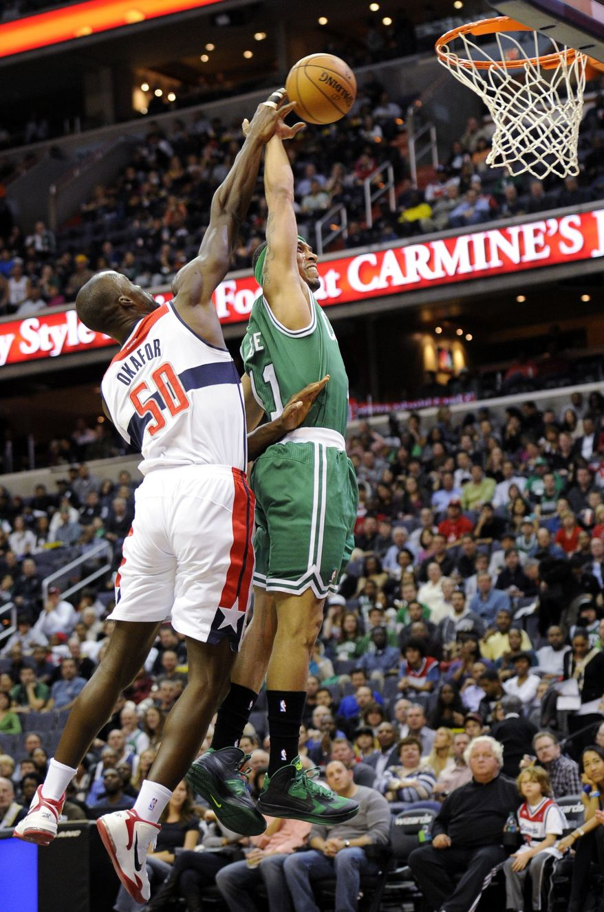 Washington Wizards center Emeka Okafor (50) defends the basket against Boston Celtics guard Courtney Lee (11) during the first half of an NBA basketball game on Saturday, Nov. 3, 2012, in Washington. (AP Photo/Nick Wass)