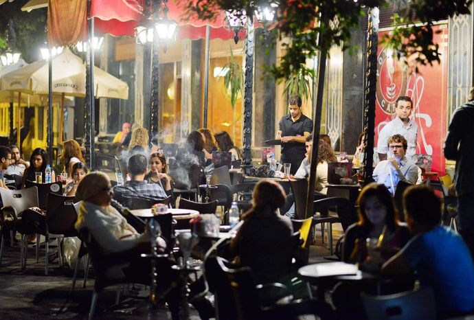 Egyptians relax outside a Cairo cafe. Crowds often fill cafes and shops that stay open late and the government is facing a backlash over forcing stores and restaurants to close earlier. Officials say the nation has to save electricity, but they also seem intent on taming a population they see as unruly. (Associated Press)