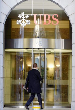 Swiss banks have come under pressure from governments around the world for their reputation for banking secrecy. Swiss banking giant UBS AG announced massive layoffs last week, along with huge losses in its third-quarter results, saying it aims to trim as many as 10,000 employees, or some 15 percent of its staff. (Associated Press)