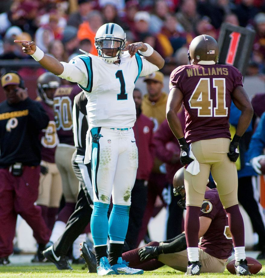 Panthers quarterback Cam Newton celebrates a first down during the first quarter. Newton threw for 201 yards and ran for 37. (Craig Bisacre/The Washington Times)