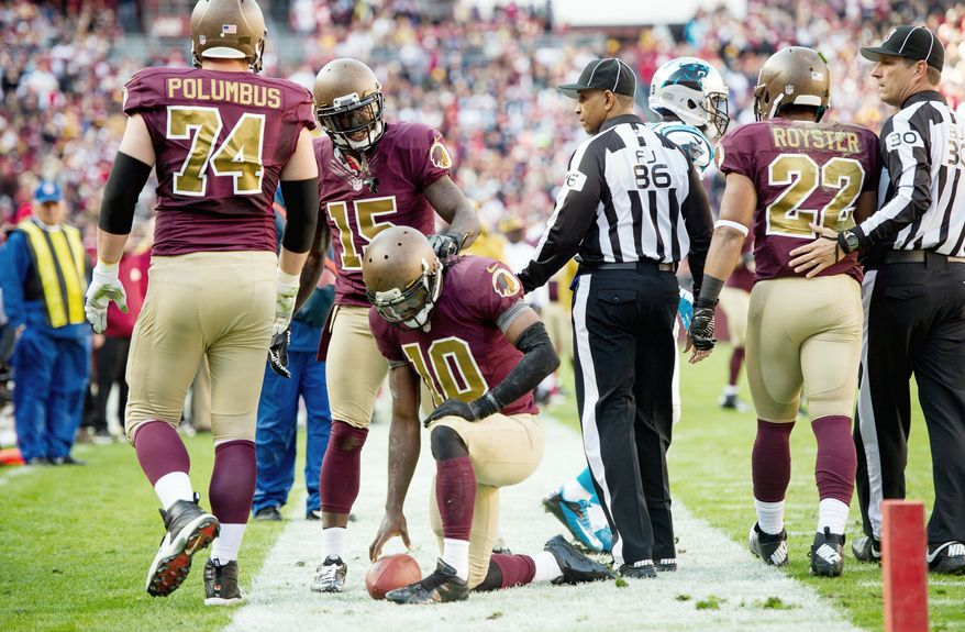 Redskins quarterback Robert Griffin III collects his thoughts after he was stoppped on the 2-yard line on fourth-and-goal during the second quarter. The Panthers drove 98 yards on the ensuing possession to take a 14-3 lead. Griffin passed for 215 yards and rushed for 53 yards on 11 carries. Washington lost 21-13 to drop to 3-6 entering its bye week. (Andrew Harnik/The Washington Times)