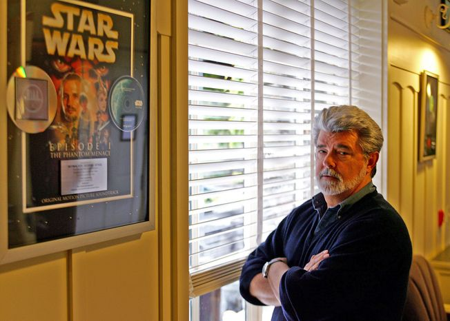 "Producer-director George Lucas, who created the ""Star Wars"" franchise, poses at Skywalker Ranch in San Rafael, Calif., in 2005. (AP Photo/Eric Risberg)"