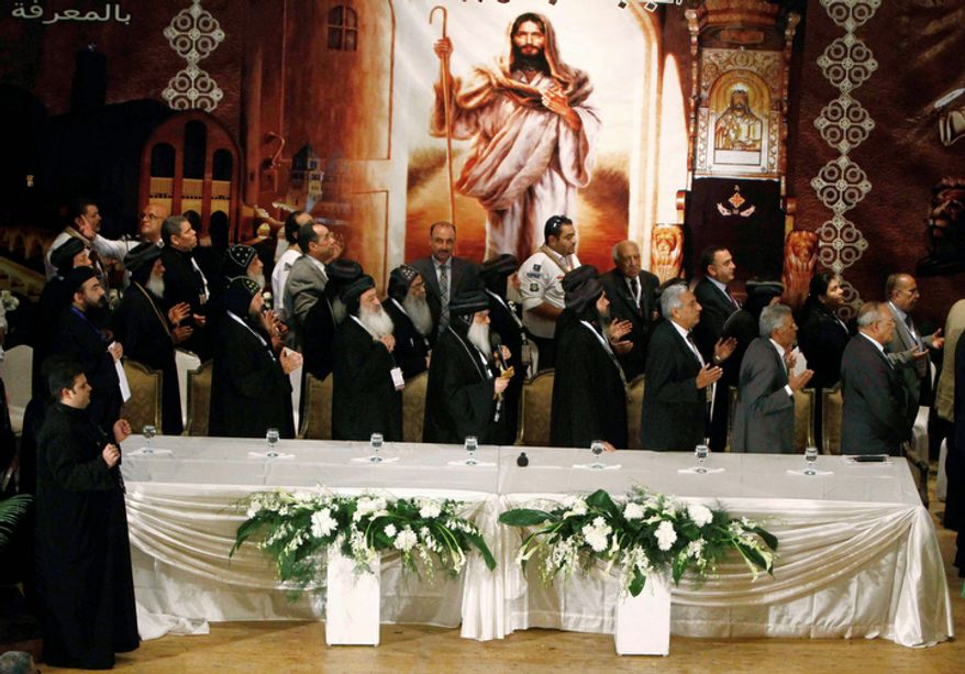 In this Monday, Oct. 29, 2012 photo, Coptic Bishops pray prior to a press conference held to announce the three finalist candidates for the new Coptic Pope in Cairo, Egypt.  (AP Photo/George Mohsen, El Shorouk Newspaper)