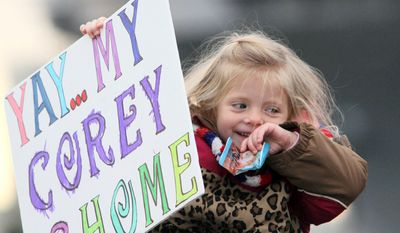 Makenna Wisk, 3, waits for her cousin Airman Corey Combs as the USS Enterprise returns to Norfolk Naval Station, as the 51-year-old ship completes its 25th and final deployment.  (AP Photo/The Virginian-Pilot, Steve Earley)