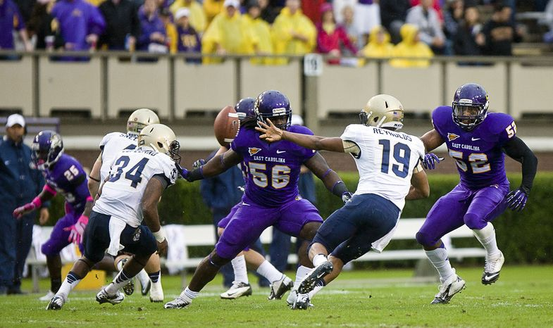 Navy quarterback Keenan Reynolds flips an option pass against East Carolina during an NCAA college football game Saturday, Oct. 27, 2012, in Greenville, N.C. Navy won 56-28. (AP Photo/The