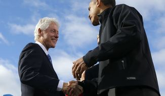 President Obama (right) and former President Bill Clinton shake hands onstage during a campaign event at Capitol Square in Concord, N.H., on Sunday, Nov. 4, 2012. (AP Photo/Pablo Martinez Monsivais)