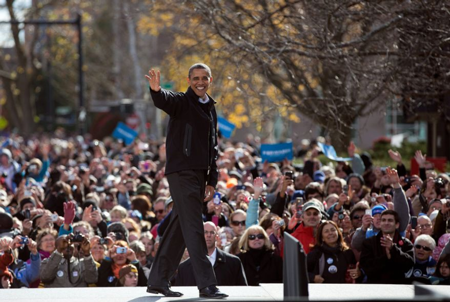 President Barack Obama waves to the cheering crowd after speaking at a campaign event in State Capitol Square, Sunday, Nov. 4, 2012, in Concord, N.H. (AP Photo/Carolyn Kaster)