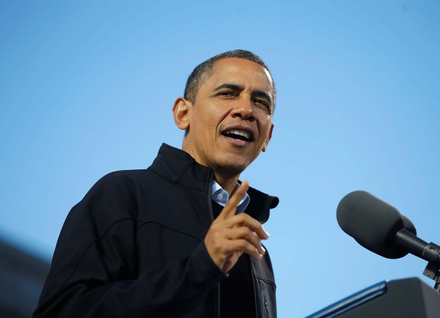 President Barack Obama speaks during a campaign event at Capitol Square, Sunday, Nov. 4, 2012, in Concord, N.H. (AP Photo/Pablo Martinez Monsivais)