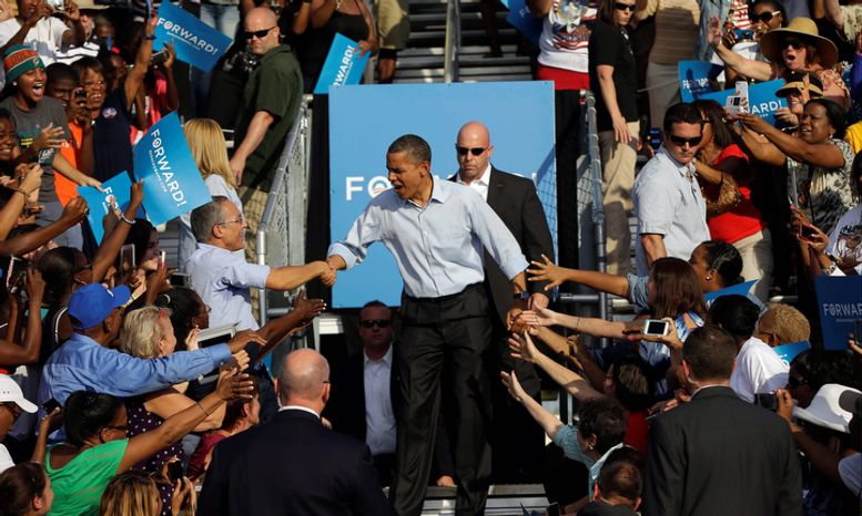 President Barack Obama greets supporters as he is introduced during a campaign event at McArthur High School, Sunday, Nov. 4, 2012, in Hollywood, Fla. (AP Photo/Pablo Martinez Monsivais)