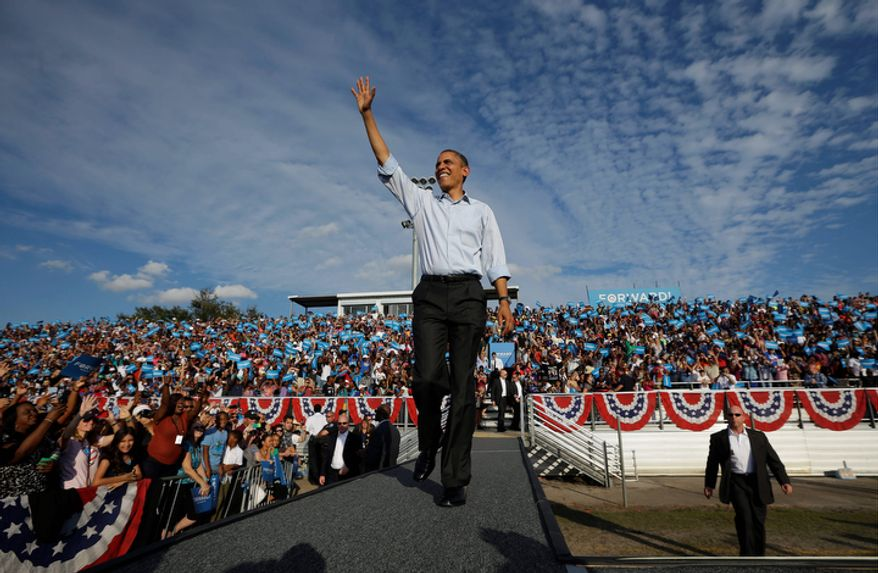 President Barack Obama waves as he is introduced before speaking to supporters during a campaign event at McArthur High School, Sunday, Nov. 4, 2012, in Hollywood, Fla. (AP Photo/Pablo Martinez Monsivais)