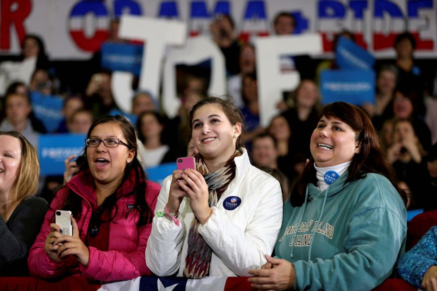 Supporters listen to Vice President Joe Biden speak during a campaign rally at Lakewood High School, Sunday, Nov. 4, 2012, in Lakewood, Ohio. (AP Photo/Matt Rourke)