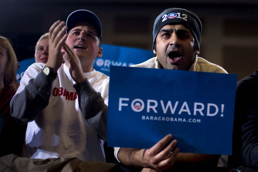 Supporters cheer as Vice President Joe Biden speaks during a campaign rally at Rushville Middle School, Sunday, Nov. 4, 2012, in Lancaster, Ohio. (AP Photo/Matt Rourke)