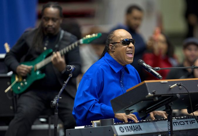 Singer Stevie Wonder performs before President Barack Obama speaks at a campaign event at the Fifth Third Arena on the University of Cincinnati campus, Sunday, Nov. 4, 2012, in Cincinnati.  (AP Photo/Carolyn Kaster)