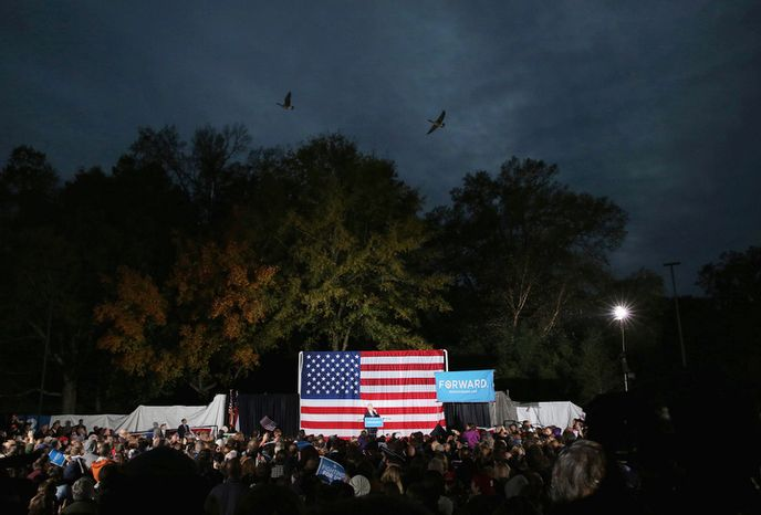 Former President Bill Clinton speaks at a rally for Barack Obama at Pullen Park in Raleigh, N.C., Sunday, Nov. 4, 2012. The former president has been traveling to several battleground states over the past week to try to stem any Republican tide for Mitt Romney and preserve Obama leads. (AP/Ted Richardson)