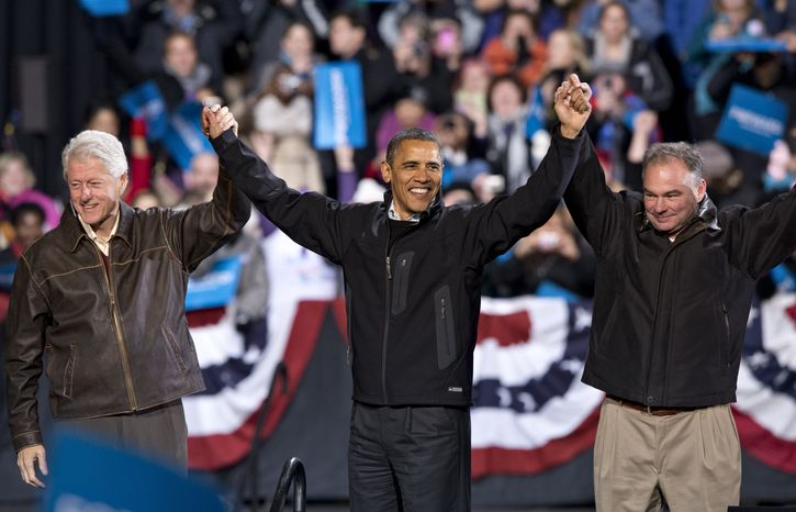 President Obama (center), in the final hours of a four-state campaign day, is joined by former President Bill Clinton (left) and former Virginia Gov. Tim Kaine, who is running for the U.S. Senate, at a rally at Jiffy Lube Live Arena in Bristow, Va., late on Saturday night, Nov. 3, 2012. (AP Photo/J. Scott Applewhite)
