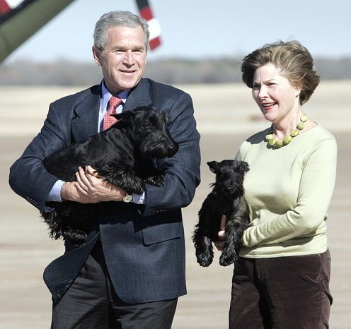 President Bush and first lady, Laura, carry their dogs, Barney and Miss Beazley, respectively, before departing from Waco, Texas on Marine One on their way to their ranch in Crawford for the remainder of the holiday, Monday,  Dec. 26, 2005. The first couple is scheduled to return to Washington after the New Year's holiday. (AP Photo/Lawre