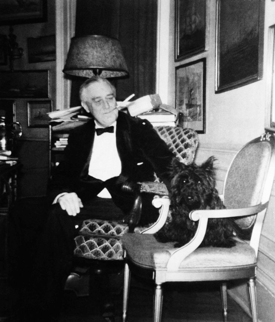 President Franklin D. Roosevelt with pet dog, a Scottish terrier named Fala.  (AP Photo)