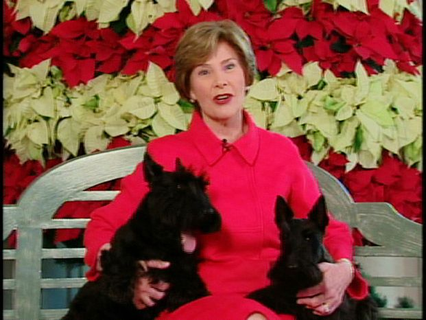 """This video image provided by the White House shows first lady Laura Bush with Barney and Miss Beazley appearing in the """"Barney Cam"""" holiday doggie video. (AP Photo/White House)"""