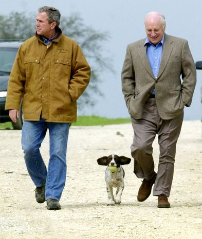 """This Nov. 11, 2000 file photo shows then Republican presidential candidate Texas Gov. George W. Bush and running mate Dick Cheney walk down a dirt road to meet with reporters, followed by Bush's dog Spot, near Crawford, Texas. For the new book """"Pets at the White House,"""" Dallas author Jennifer Boswell Pickens interviewed everyone from first family members to White House staffers to give readers a glimpse at what life is like at 1600 Pennsylvania Ave. for pets and what those pets have meant to their famous owners. (AP Photo/Eric Draper, file)"""