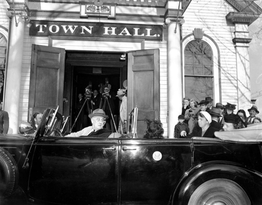 U.S. President Franklin D. Roosevelt and Eleanor Roosevelt watch as their Scottish Terrier dog, Fala, hops onto the jump seat as they leave town hall in Hyde Park, N.Y., on Nov. 4, 1941. President Roosevelt had just finished voting in a local election. Seated next to the First Lady in the backseat is Princess Juliana of the Netherlands. (AP Photo)