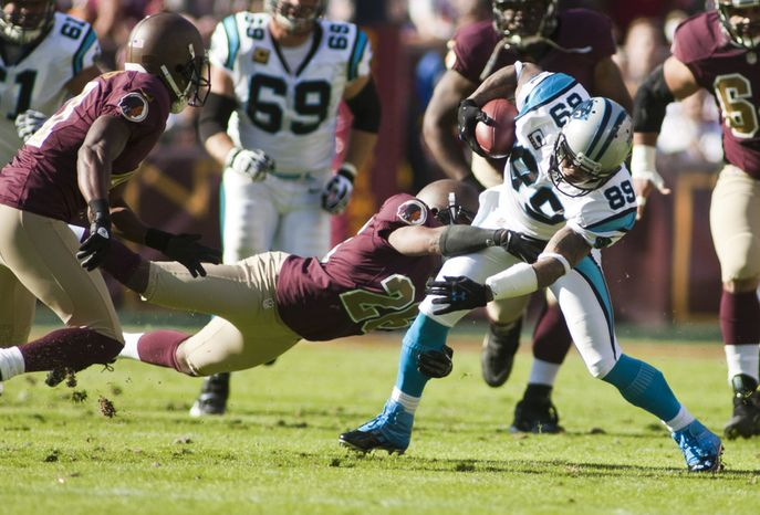 Washington Redskins cornerback Josh Wilson (26) can't bring down Carolina Panthers wide receiver Steve Smith (89) as he runs after the catch for a first down in the first quarter, Landover, Md., Sunday, November 4, 2012.  (Craig Bisacre/The Washington Times)
