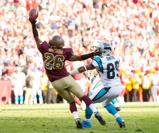 Washington Redskins cornerback Josh Wilson (26) is called for defensive pass interference on a ball intended for Carolina Panthers wide receiver Steve Smith (89) as the Washington Redskins take on the Carolina Panthers at FedEx Field, Landover, Md., Sunday, November 4, 2012. (Andrew Harnik/The Washington Times)