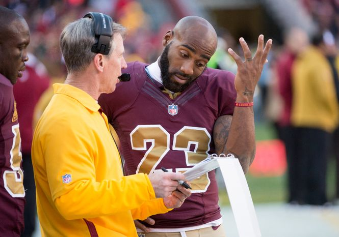 Washington Redskins cornerback DeAngelo Hall (23) talks with a coach on the sideline late in the fourth quarter as the Washington Redskins take on the Carolina Panthers at FedEx Field, Landover, Md., Sunday, November 4, 2012. (Andrew Harnik/The Washington Times)
