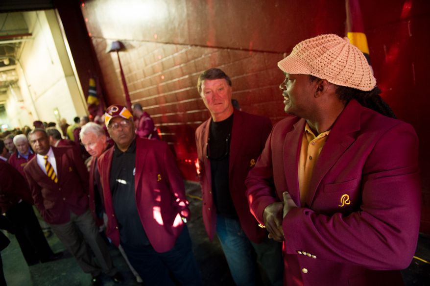 Former Washington Redskins linebacker Lavar Arrington, right, and other former Washington Redskins players wait inside the tunnel to take the field as part of the annual Washington Redskins Homecoming festivities before the Washington Redskins take on the Carolina Panthers at FedEx Field, Landover, Md., Sunday, November 4, 2012.(Andrew Harnik/The Washington Times)
