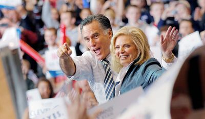 Republican presidential candidate and former Massachusetts Gov. Mitt Romney with his wife Ann greet supporters during a campaign rally at the International Exhibition Center  in Cleveland, Sunday Nov. 4, 2012. (AP Photo/Jerome Delay)