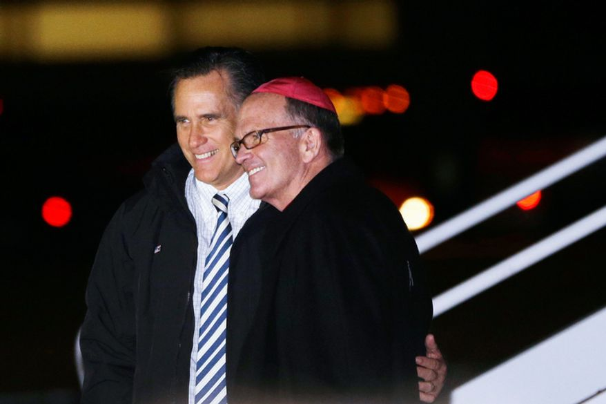 Republican presidential candidate and former Massachusetts Gov. Mitt Romney meets with Bishop David M. O'Connell of Trenton, N.J., as he steps off his campaign plane in Philadelphia, Sunday, Nov. 4, 2012. (AP Photo/Charles Dharapak)