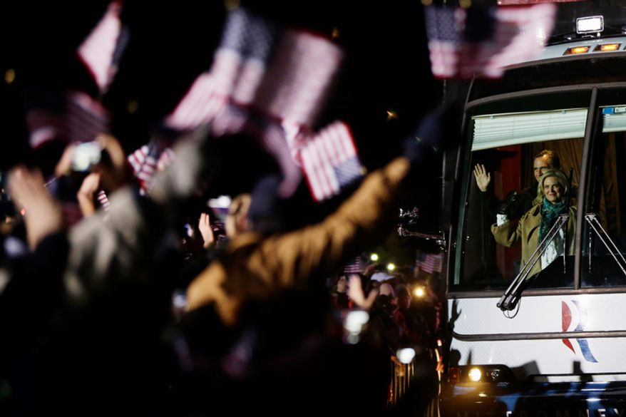 Republican presidential candidate and former Massachusetts Gov. Mitt Romney and Ann Romney arrive on their campaign bus at a Pennsylvania campaign rally at Shady Brook Farm, in Morrisville, Pa., Sunday, Nov. 4, 2012. (AP Photo/Charles Dharapak)