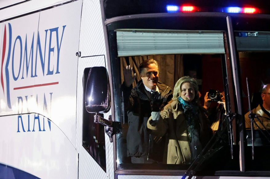 Republican presidential candidate and former Massachusetts Gov. Mitt Romney and wife Ann wave from their bus as they arrive at a Pennsylvania campaign rally at Shady Brook Farm, in Morrisville, Pa., Sunday, Nov. 4, 2012. (AP Photo/Charles Dharapak)