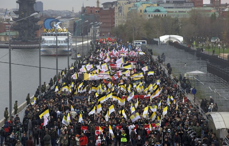 Ultranationalist demonstrators and activists march carrying the Russian Empire's black, yellow and white flag to mark National Unity Day, on the outskirts of Moscow o