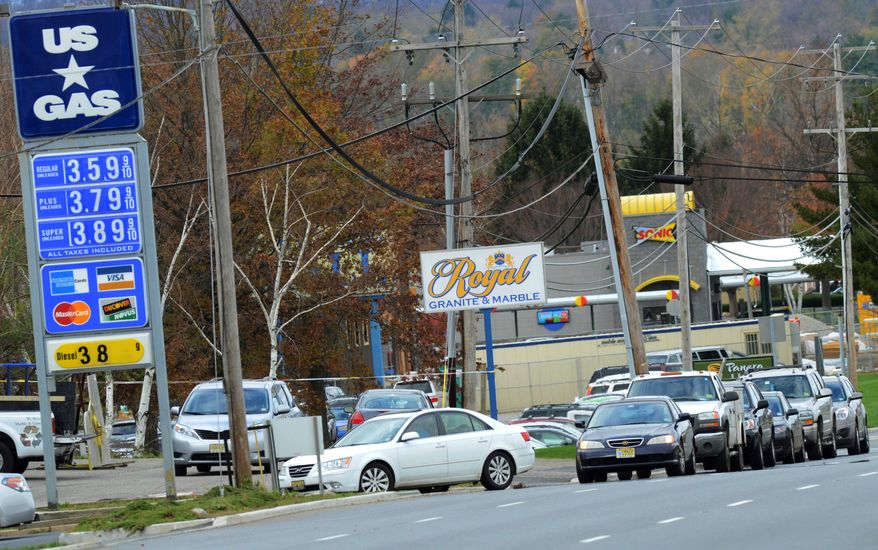 Customers line up along Route 22 East at the US Gas, Saturday, Nov. 3, 2012, in Pohatcong Township, N.J., as the gas rationing ordinance goes into effect. Weary of cleaning up from the superstorm that battered the state and with more than 1 million of them still without power, New Jerseyans were handed a new challenge Saturday: rationed gas in the northern half of the state, a system that caused confusion, frustration and desperation. (AP Photo/The Express-Times, Stephen Flood)