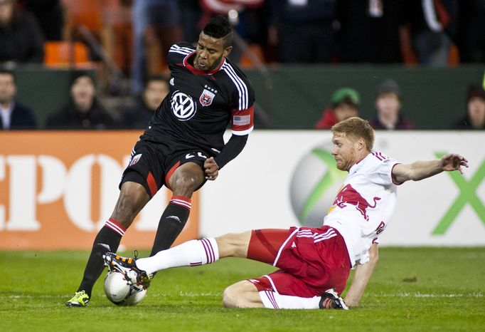 D.C. United forward Lionard Pajoy (26) dodges New York Red Bulls defender Markus Holgersson (5) during the first half of the Eastern Conference semifinals playoff match at RFK Stadium, Washington, D.C.