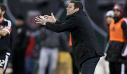 D.C. United coach Ben Olsen yells at his team during the first half against New York Red Bulls in the Eastern Conference semifinals playoff match at RFK Stadium, Washington, D.C.,  Saturday, Nov. 3, 2012. (Craig Bisacre/The Washington Times)