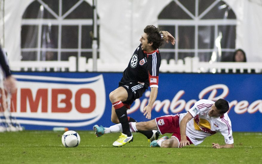 D.C. United defender Dejan Jakovic (5) is fouled by New York Red Bulls forward Sebastien Le Toux (9) during the first half of the Eastern Conference semifinals playoff match at RFK Stadium, Washington, D.C.,  Saturday, Nov. 3, 2012. (Craig Bisacre/The Washington Times)