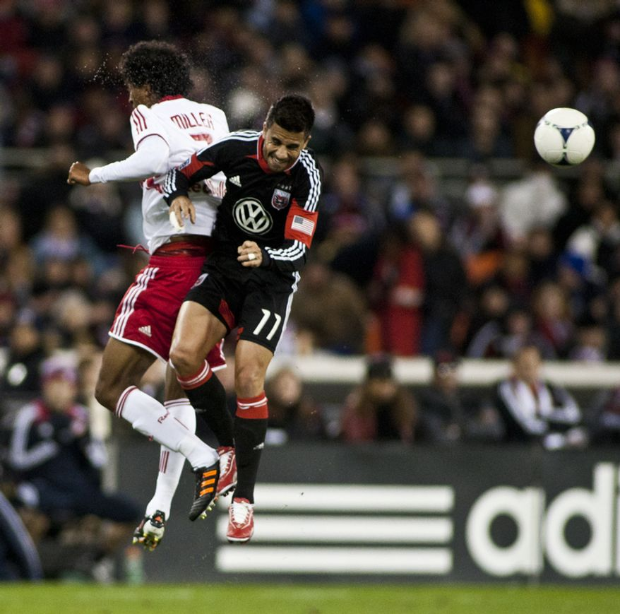 D.C. United midfielder Marcelo Saragosa (11) fights for possesion against New York Red Bulls defender Roy Miller (7) during the second half of the Eastern Conference semifinals playoff match at RFK Stadium, Washington, D.C.,  Saturday, Nov. 3, 2012. (Craig Bisacre/The Washington Times)