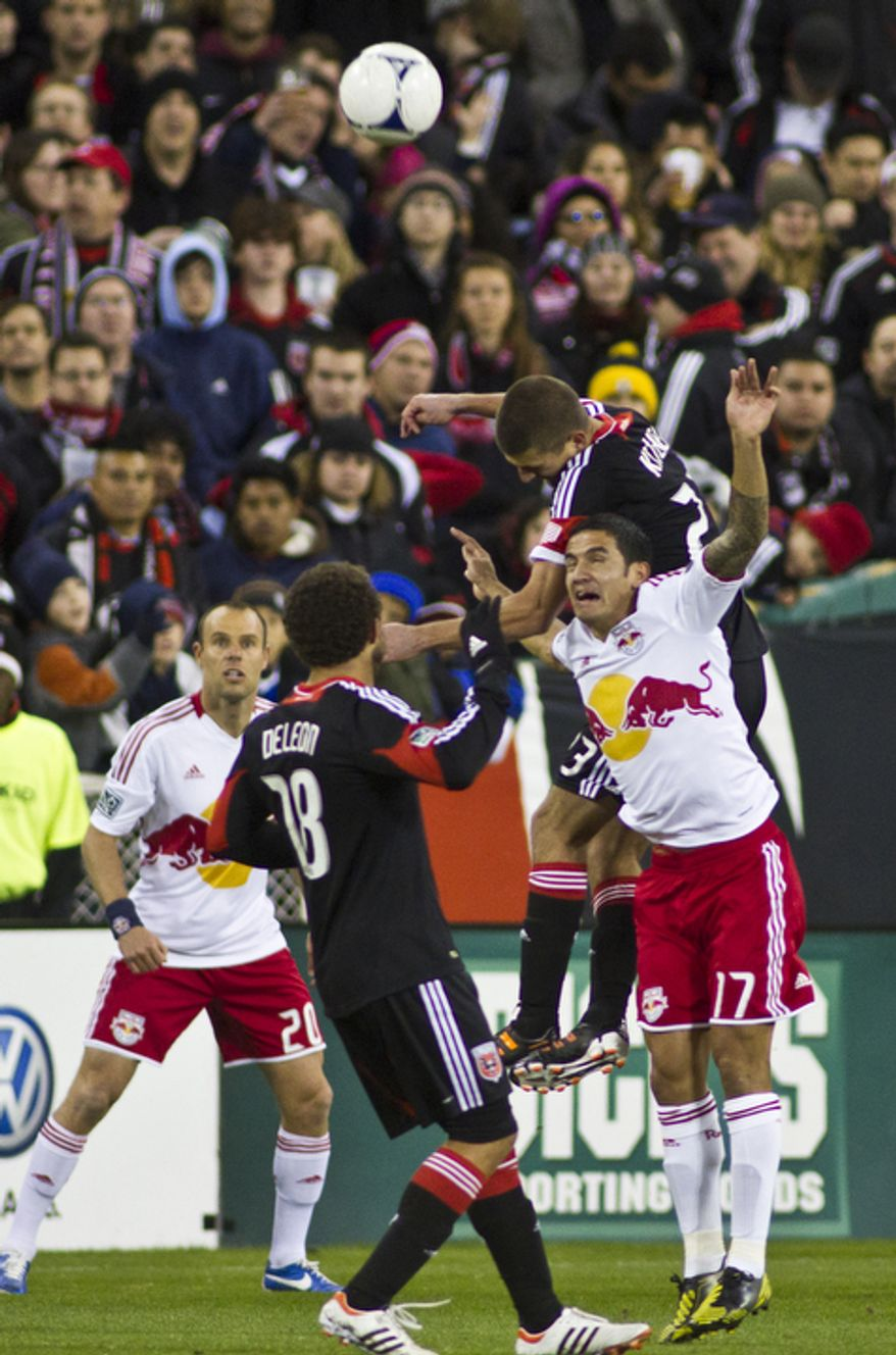 D.C. United midfielder Perry Kitchen (23) goes up for a header against New York Red Bulls defender Tim Cahill (17) during the first half of the Eastern Conference semifinals playoff match at RFK Stadium, Washington, D.C.,  Saturday, Nov. 3, 2012. (Craig Bisacre/The Washington Times)