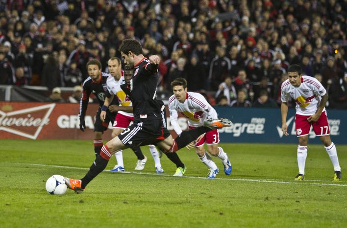 D.C. United midfielder Chris Pontius (13) misses a penalty kick during the first half against the New York Red Bulls in the Eastern Conference semifinals playoff match at RFK Stadium, Washingt