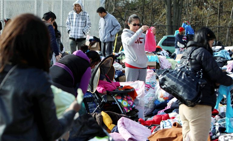 People sort through donated clothes at an aid station in Staten Island, New York. The Federal Emergency Management Agency said it has already dispensed close to $200 million in emergency housing assistance after Superstorm Sandy, but finding enough long-term housing could be problematic. (Associated Press)