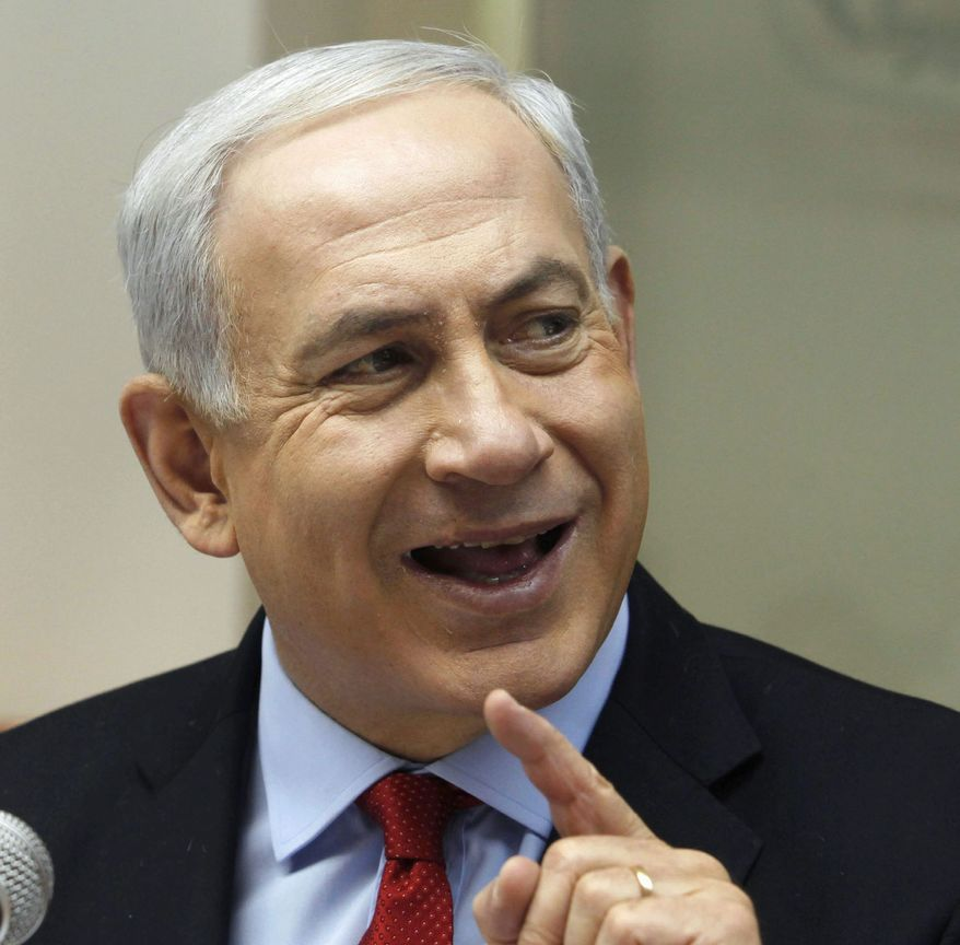 FILE - In this Sunday, Nov. 4, 2012 file photo, Israeli Prime Minister Benjamin Netanyahu attends a weekly cabinet meeting in Jerusalem. Netanyahu ordered the military in 2010 to go on high alert for a looming attack on Iran's nuclear program, but backed off following strong objections from senior security officials, according to an Israeli news program. The show suggests Israel came close to carrying out the strike, and exposes a deep rift between Prime Minister Benjamin Netanyahu and his top security men over the wisdom of attacking Iran. (AP Photo/Gali Tibbon, Poo, File)